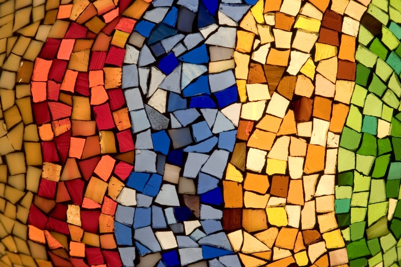 This image shows a colorful tile mosaic, with curvy columns of red, blue, yellow and green