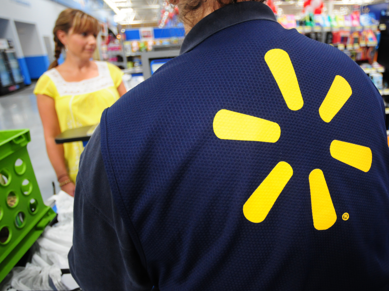 A close-up of Walmart's star logo is seen on the back of an employee's shirt inside a store. This blog post explores how Brightspot helped Walmart shift its corporate communications strategy.