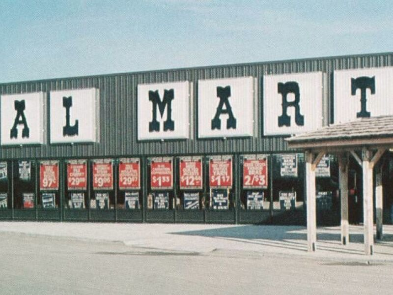 The entrance to a 1970s era Walmart is seen with sale signs hanging in the windows. Learn how Walmart and other heritage brands are using Brightspot to stay relevant.