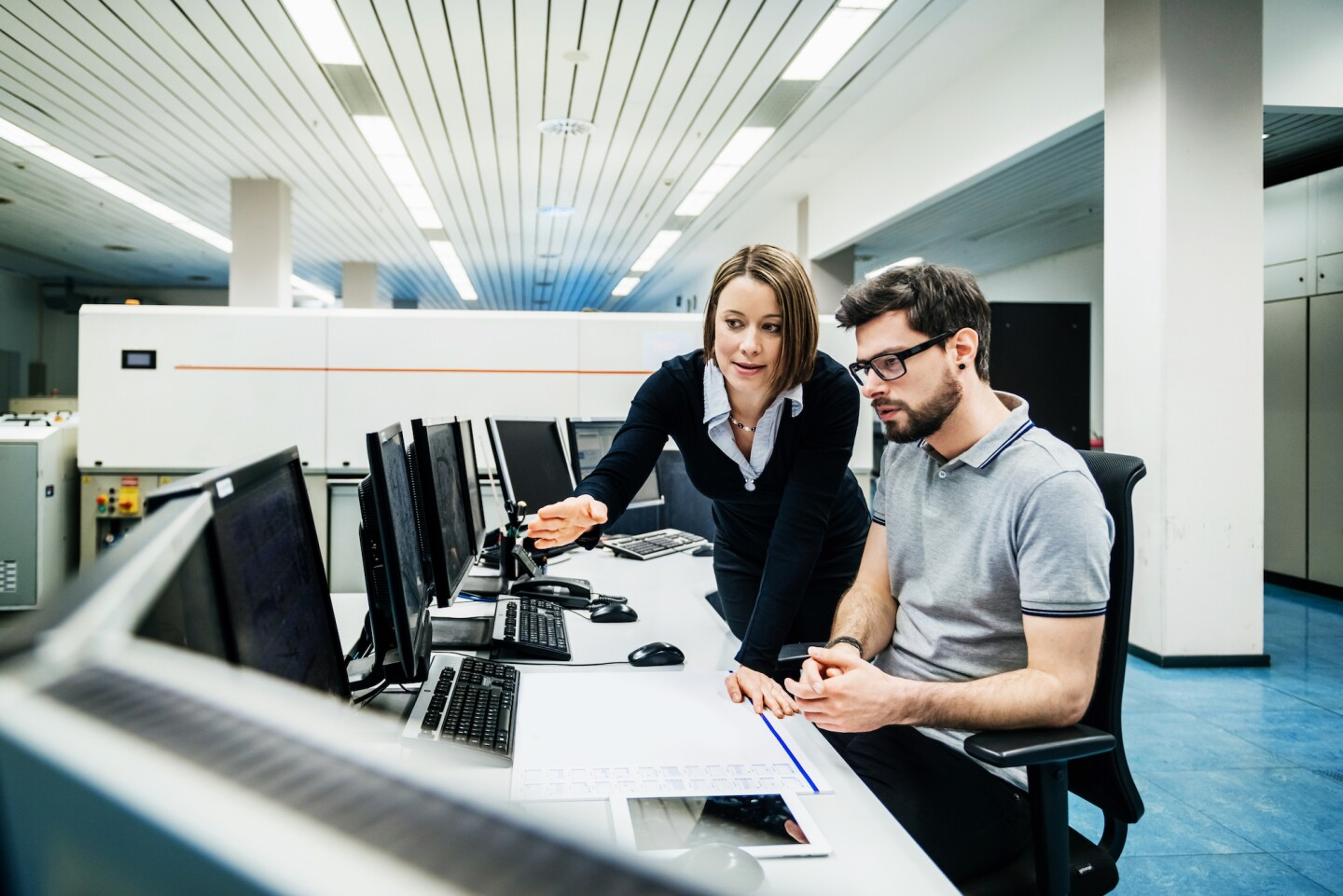 Operations Manager Working With Engineer At Computer